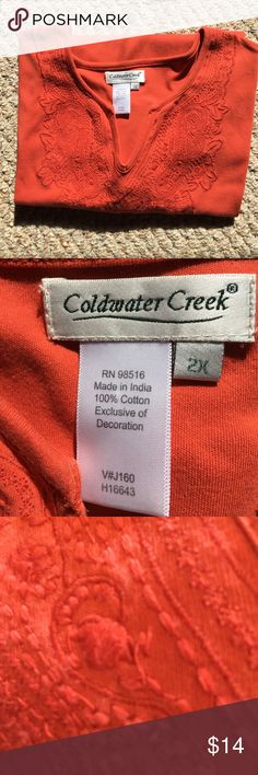 "COLDWATER CREEK orange embroidered v neck tee  COLDWATER CREEK burnt orange with very pretty embroidered v neck, tee.  100% cotton.  Details:  Machine wash cold, tumble dry low.  2X : back 25"", chest 48"".  Stored in a smoke free home. Coldwater Creek Tops Tees - Short Sleeve"