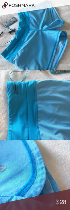 Lululemon Blue Running Lined Shorts Lululemon torquise blue running shorts.  Features two inner pockets and a zipper pocket in the back and a darker blue lining.   I'm unable to give you the materials, because the tag was cut off by my sister!!!  They are in excellent condition there's no pilling or pulling on the fabric. lululemon athletica Shorts