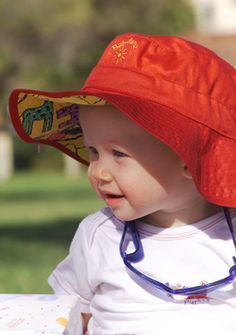 So, Josiah has my complexion, which means he needs lots of sun protection. I saw a lady at a Michigan farmers' market whose baby had a hat like this. His was hula baby, but since that is apparently custom clothing, I think I will look at some other options like this:)