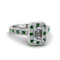 Shop emerald cut diamond encased basket halo ring with green emerald in 14K white gold at Fascinating Diamonds. This diamond engagement ring is designed in Pave setting