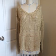 Gold mixed metallic button back sweater Gold sweater with interwoven metallic thread. Loose open knit. Tshirt hem style bottom. Gold button back. Mine Sweaters