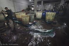Workers mix the dye with additives, inside a factory in the Binhai Industrial Zone. © Qiu Bo / Greenpeace