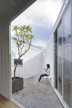 """Away from the hustle, the triangular courtyard provides a quiet space. 'The triangular sky""""cafe by A.R.Architect in Tainan city made from shipping container is strikingly bright and airy ! #cafeshop #tainanfood #architect #cafes #retaildesign"""