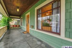 1912 Bungalow, Pasadena, CA - paint colors: muted turquoise siding, putty trim and reddish-brown window sash
