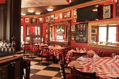 Miami's Most Iconic Dining Rooms: Randazzo's Little Italy on Miracle Mile is the epitome of a family-style Italian spot with the tiled floors, checkered table cloths, and array of photos of famous Italians on the walls.
