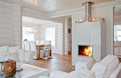 The fireplace again, in Kontio Kruunuhaka Helsinki Cabin Homes, Log Homes, Home Interior, Modern Interior, Cottage Design, House Design, White Fireplace, Wood Fireplace, Scandinavian Home