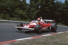 The German Grand Prix Nürburgring August 1 1976 Nikki Lauda flying with is Ferrari at Flugplatz during practice In the race he had a suspension. Ferrari F1, Ferrari Racing, F1 Racing, Drag Racing, James Hunt, F1 Wallpaper Hd, Up Auto, Classic Race Cars, Formula 1 Car