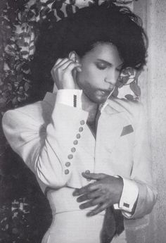 """Prince right between the Graffiti Bridge/Nude Tour era and the Diamonds & Pearls era, before the """"Typhoon"""" hair style."""