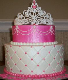 Cake for a one-year-old princess. The smash cake is the top tier. My first royal icing tiara!