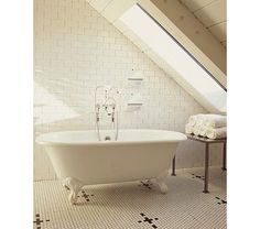 master bathroom with mosaic tiles, a claw foot stand alone tub and floor to ceiling white subway tiles - Home and Garden Design Ideas