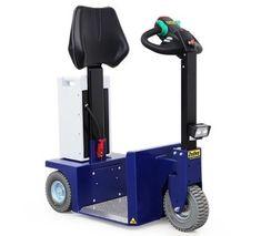 K2 Zallys, Elektrický Tříkolový Transportní Prostředek - Tahač Se Stojícím Řidičem. Rychlost - 10km/h; Tažná kapacita až 1 500kg; Max. sklon - 15%. Tažné zařízení s rychlým připojením a odpojením nosičů nákladu. Snadná přeprava osob a tažení vozíků ve výrobě, v obchodě a v logistice.