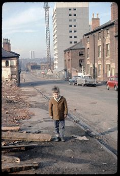 https://flic.kr/p/4nBijE | Great Russell St, Birmingham, 1967 | During the enforced mass demolition of homes, with the grim tower-blocks of the 1970s being constructed behind. Photo by Phyllis Nicklin, who was a Geography lecturer at Birmingham University.