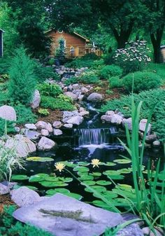 There are some backyard waterfall ideas that really great to your landscape. These backyard waterfall ideas can add visual interest and of course, can make a statement to your backyard. Sloped Backyard, Backyard Water Feature, Pool Water Features, Water Features In The Garden, Pond Landscaping, Landscaping With Rocks, Pond Fountains, Garden Waterfall, Water Pond