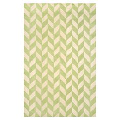Anchor a neutral seating group or define space in the den with this hand-tufted wool rug, featuring a chic chevron-inspired motif in green.    ...
