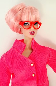 This outfit is so cool in so many ways! Hot pink with a cropped jacket, collar, 3 faux gold buttons and a unique blousing sleeve. Matching skirt with inverted center pleat. Red rimmed glasses to reall