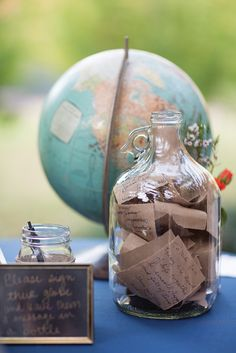 Unique keepsake. Have your guests sign a globe and leave a message in a bottle. Jade and Matthew McCully