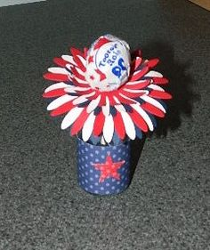 A little 4th of July Tootsie Pop Firework treat in a mini vase or bottle.  Happy Crafting!~ Dee