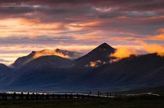 Keep Breathing~  Brooks range mountains along Dalton Highway with the alpenglow of the cloud at midnight - Summer 2011, Alaska, USA  Below the mountains, you could notice the famous trans-alaska pipeline system  http://500px.com/photo/26473587
