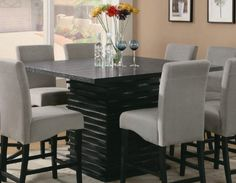 "Black Counter Height Dining Table - Coaster 102068 Efurnitureshowroom by Coaster Home Furnishings. Save 22 Off!. $522.48. Some assembly may be required. Please see product details.. The Black Counter Height Dining Table from Coaster is great for casual dining. The square dining table is constructed from select hardwoods and veneers. It is usually in stock and ships to you at no additional charge.Black Counter Height Dining Table Dimensions:Table (Coaster Model 102068) 54 L x 54"" W x 36"" H"""