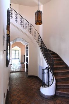 Spanish Colonial <3. I love how the hallway centers on a view.
