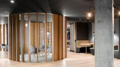 SLACK European HQ OFFICE. For Slack's new offices, which span 2700 square metres of the One Park Place building on Hatch Street in the city centre, ODOS Architects chose a dark colour palette and a winding layout inspired by the office's locality.