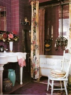 dark tiled bohemian bathroom