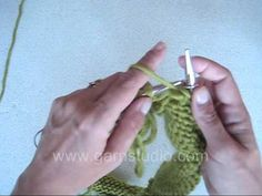 In this DROPS video we slip sleeves on the same needle as body piece where bind off for armholes. Insert a marker in all transitions between body piece and s...