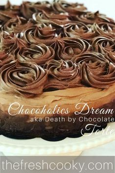 DEATH BY CHOCOLATE! Brownie base, ganache center, mousse top, swirled with a delicious buttercream! #chocolate #torte #thefreshcooky #mousse #deathbychocolate