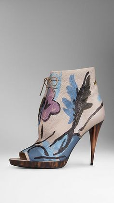 Hand-Painted Leather Ankle Boots | Burberry - in Stone Blue -   Elegant peep-toe ankle boots in hand-painted deerskin. Each boot is a one-off design and entirely unique, crafted from panels that have been painted with floral artworks. The 11.5cm/4.5in heel and platform feature horn-look polyester, inspired by the classic buttons on the Burberry trench coat. Cotton laces are wax-coated, while the insoles are lined in soft leather that has been padded for comfort.