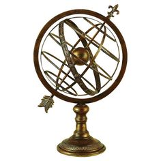 Perfect displayed on your home office desk or grouped with well-traveled accents in the entryway, this armillary decor features an antiqued gold finish for a...