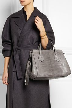 Gray crocodile and leather (Calf) Zip fastening along top Comes with dust bag Crocodile: Australia