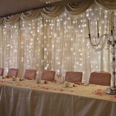 twinkle lighting and fabric dance floor backdrop