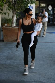 She was spotted carrying North and wearing Yeezy Boosts to dance class. | Kim Kardashian Isn't Blonde Anymore