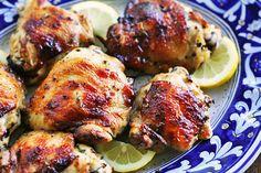 Lemon Chicken Recipe Main Dishes with chicken parts, lemon zest, lemon juice, garlic, thyme, rosemary, kosher salt, black pepper, melted butter, lemon slices