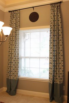 """My customized Target """"Farrah Fretwork"""" curtain panels in blue. I bought a pair of 95"""" panels and added 25"""" from a solid blue """"Farrah"""" panel to lengthen the bottom for my dining room. Color goes perfectly with Benjamin Moore paint in Coventry Gray. #Target Curtains"""