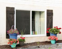 DIY Wood Shutters For Under $40 - Looking to get rid of my red shutters and posts.