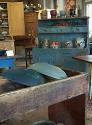 Love the blue cupboard and the bowls......AND I want all of them :)
