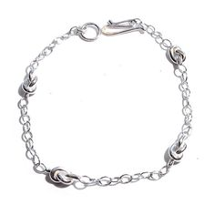 "Sweet sterling silver handmade knot bracelet. This bracelet is perfect for Valentine's Day, or just as a gift for yourself! The knots measures 7.5 x 4.8mm. This means each is approximately 1/4"". The k"