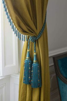 Teal trimming and tieback on mustard yellow curtain