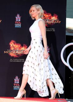 Jennifer Lawrence Shows How to Bring Chic Balance to the Asymmetric Skirt. Jennifer's pale lavender manicure by Jenna Hipp @ Nailing Hollywood.