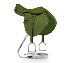 Hermes Steinkraus mini saddle statue in grass green Niloticus crocodile leather, with nickle plated brass saddle support... The Steinkraus saddle was developed in the 1960's, in collaboration with well-known American show jumper William Steinkraus. Designed with show jumping and hunting in mind, this mini-replica calls to mind the saddle's mark of competitive riding: understated and natural, with a certain sense of stlye and elegance.