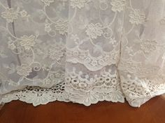 Vintage cream lace fabric, fully embroidery with cotton floral . Embroidered with nice cotton floral pattern . Retro feeling . Finished border on both sides with crochet design . * Floral embroidered lace fabric: natural cream , gauze, embroider on cotton floral * Width 47 inch (120cm),