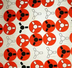 """Angelo Testa; IBM Disk Fabric, 1950s. Textile designer Angelo Testa produced bold, brightly colored prints to accompany modern architecture. This pattern on linen from the 1950s, called """"IBM disks"""" was inspired by computer tape reels and was probably made for an IBM business office. #blackandred"""