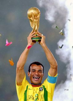 Cafu, Brazil's captain, lifts the World Cup trophy in 2002, after his side beat Germany 2-0 in the final in Yokohama, Japan.
