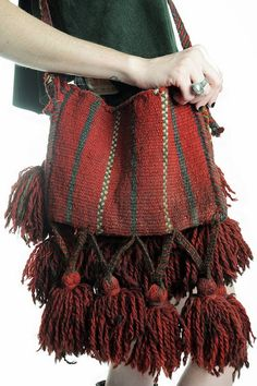 The tassels! A simple bag made of hand-woven fabric from South America would do to make something like this.