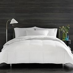 Sleep in luxurious comfort and provide yourself with year-round warmth with the irresistible Real Simple Down Comforter. This single-ply, 350-thread-count comforter features lofty duck down, breathable construction, and an impressive 500 fill power.