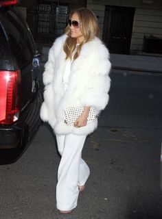 Jennifer Lopez brought glamor to the 'Today Show' in a fluffy white fur coat and matching wide-leg trousers.
