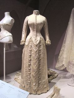 1880 Silk satin with machine-made lace, beading and embroidery by Charles Frederick Worth, whom many consider to be the Father of Haute Couture.