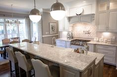 Cambria's Berwyn™ Kitchen Install | Wardson Construction Inc: The Berwyn design is infused with soft colors that are timeless yet stylish, and work beautifully in this award-winning kitchen with an open floor plan to the family room.