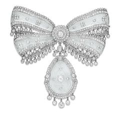 A SUPERB BELLE EPOQUE DIAMOND AND ROCK CRYSTAL BOW BROOCH, BY CARTIER. Signed Cartier,  circa 1910 [Slight contrast enhancement to better see the design]